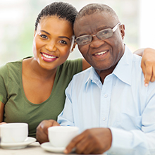 United Zion - Care - young adult african girl and father having coffee
