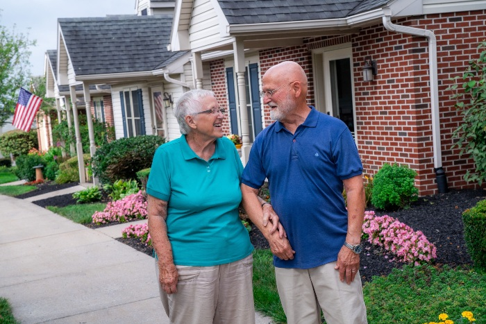 Couple walking outside at United Zion Retirement Community